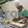 Payten Ruby, 11, cuts her apple squares into sample sizes Saturday at Cooking for Kids' Sake, which benefits Big Brothers Big Sisters of DeKalb County.