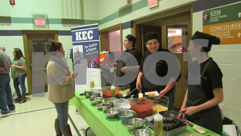 Kishwaukee Education Consortium culinary arts program students Marcella Garcia (from left), 16; Michael Rameriz, 16; and Andrea Trejo, 16, prepare food at the pasta bar during the event.