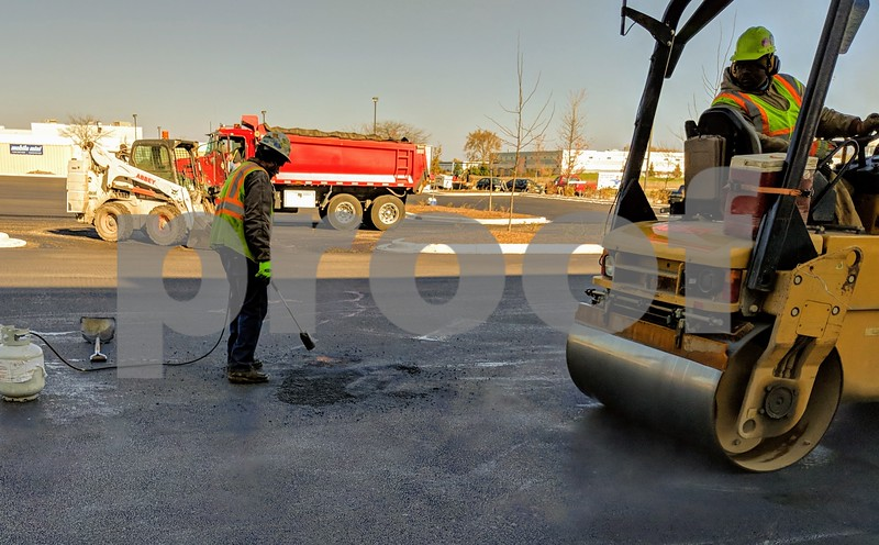Crews from Krusinski Construction Co. were were laying asphalt on Wednesday at the new warehouse on Aster Road. Construction should be completed by the end of the year, Pacer said, and operations should commence by February.