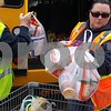 Christopher Heimerman – cheimerman@shawmedia.com<br /> Christine Urich (middle) and Denise Cagle unload nonperishable food items Tuesday morning in the Salvation Army parking lot.
