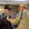"Veteran volunteer Roger Pelkey (right) places a pin on 95-year-old World War II Army veteran Henry ""Hank"" Joesten's lapel Thursday during the Veterans Day Pinning Ceremony at DeKalb County Rehab and Nursing Center in DeKalb. Each of the 36 veterans in attendance received a pin and certificate to thank them for their service."