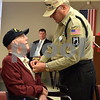 Veteran volunteer Roger Pelkey, right, places a pin on World War II Army veteran Wally Waldhier's lapel Thursday, Nov. 9, during the Veterans Day Pinning Ceremony at DeKalb County Rehab and Nursing Center in DeKalb. Each of the 36 veterans in attendance received a pin and certificate to thank them for their service.