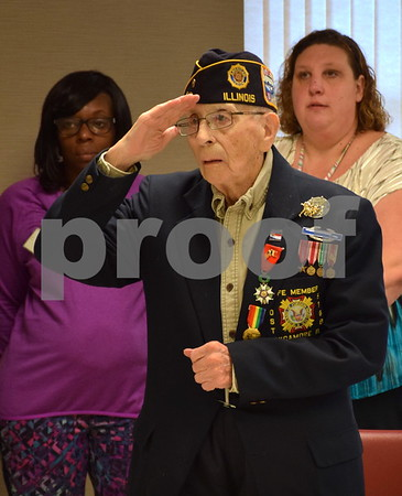 World War II Army veteran Donald Schoo, 93, salutes the American flag during the Veterans Day Pinning Ceremony at DeKalb County Rehab and Nursing Center in DeKalb. Each of the 36 veterans in attendance received a pin and certificate to thank them for their service.