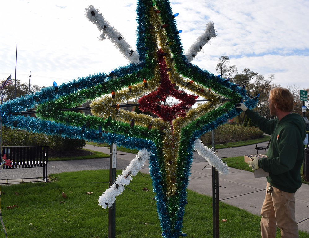 . Briana Contreras � The Morning Journal <br> Lakeview Park\'s Park Manager, Bryan Goldthorpe finishes the lights on a Christmas decoration Nov. 9 in preparation of Lights on the Lake. The full display will be lit Nov. 25 at dark and will keep the park bright through the end of December.