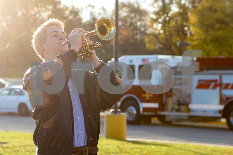 Sam Buckner for Shaw Media.<br /> Sam Hancock plays taps before school at the Veterans Day celebration on Friday November 11, 2016.