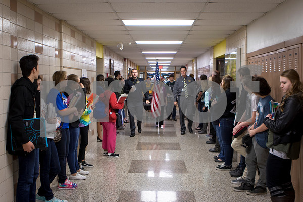 Sam Buckner for Shaw Media.<br /> Students at Sycamore High School fill the halls as a drumline followed by veterans pass by on Friday November 11, 2016.