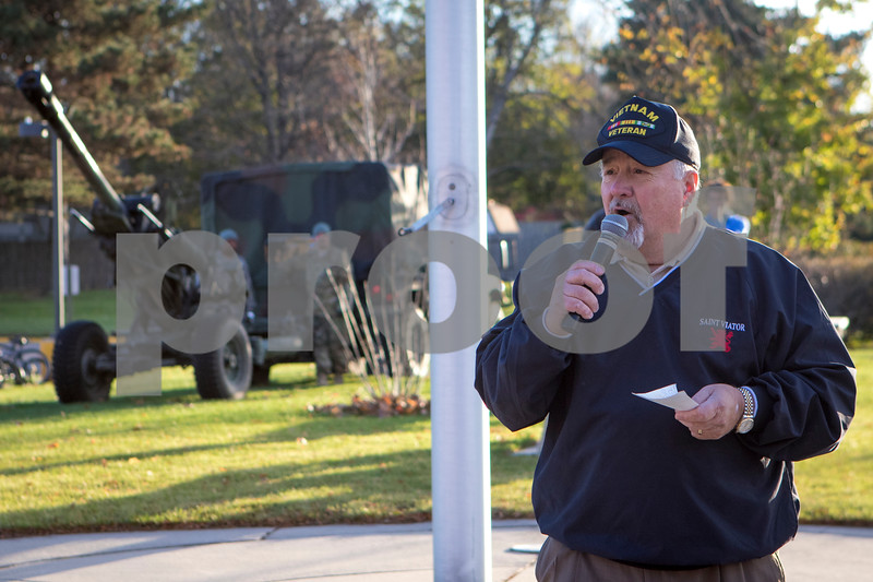 Sam Buckner for Shaw Media.<br /> Larry Forsberg welcomes the attendees of the Veterans Day attendees at the flagpole outside of Sycamore High School on Friday November 11, 2016.