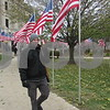 Veteran Jonathan Adkins walks in front of the DeKalb County Courthouse during his shift at the Veterans Day vigil Saturday.