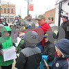 Veteran Joshua Hoffman (in red) talks with Scouts from Cub Scout Troop 141 during the 24-hour Veterans Day vigil Saturday.