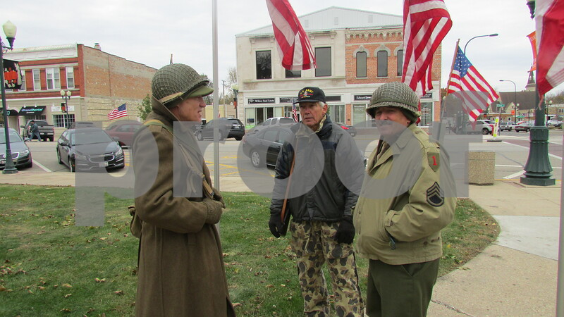 Veterans Larry Splinter of Wisconsin, Dwayne Adkins and Steve Munz, both of Sycamore, talk during the 24-hour vigil Saturday at the DeKalb County Courthouse.