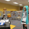 Jasmine Jackson, 16, of DeKalb waits to be judged during the costume contest at the Sycamore Public Library's ComiCon event Saturday as Cynthia Rivera, 15, waits her turn.