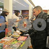 Kevin Crittenden looks over merchandise for sale from The Gaming Goat in DeKalb at the Sycamore Public Library's ComiCon event Saturday.