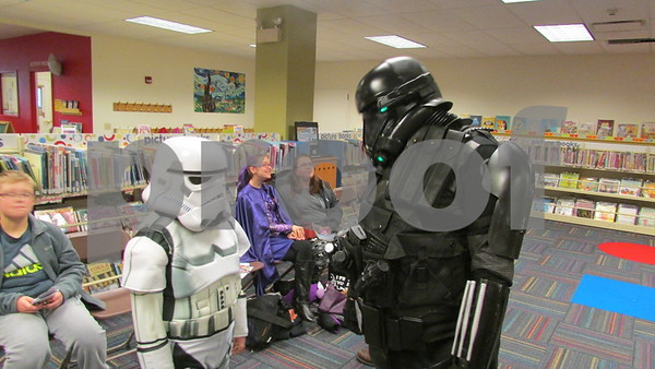 Kevin Crittenden, 31, chats with stormtrooper Tyler Cary, 10, of Sycamore during ComiCon at the Sycamore Public Library.
