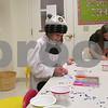 Riley Huneke, 5, of Malta makes a superhero mask Saturday at the Sycamore Public Library's ComiCon event.