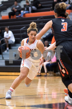 Sam Buckner for Shaw Media.<br /> Raquel Mills drives to the basket in a game against Harlem on Tuesday November 15, 2016.