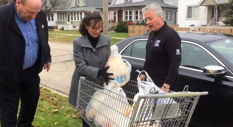 """Bill Davey and Jackie Schairer of First State Bank in Sycamore drop off 10 turkeys Friday at The Salvation Army during the """"Let's Talk Turkey"""" drive."""