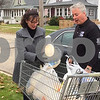 "Bill Davey and Jackie Schairer of First State Bank in Sycamore drop off 10 turkeys Friday at The Salvation Army during the ""Let's Talk Turkey"" drive."