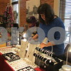 Aimee Barrows for Shaw Media<br /> Artisan Diane Maurer rearranges her gem stone art and jewelry at the KVAL Holiday Arts and Crafts Market.