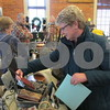 Aimee Barrows for Shaw Media<br /> Karen Kuhn of Sycamore browses handmade purses at the KVAL Holiday Arts and Crafts Market.