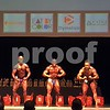 Men show of their musculature in the crab pose Saturday at the OCB Midwest States bodybuilding competition at the Egyptian Theatre in DeKalb.