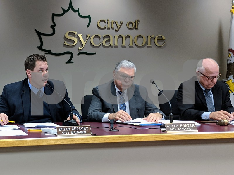 Sycamore City Manager Brian Gregory (from left) presented the various tax levy options the City Council could choose from as City Attorney Keith Foster and Mayor Curt Lang listened. The council voiced its support for an option that would keep the levy the same while lowering the tax rate.