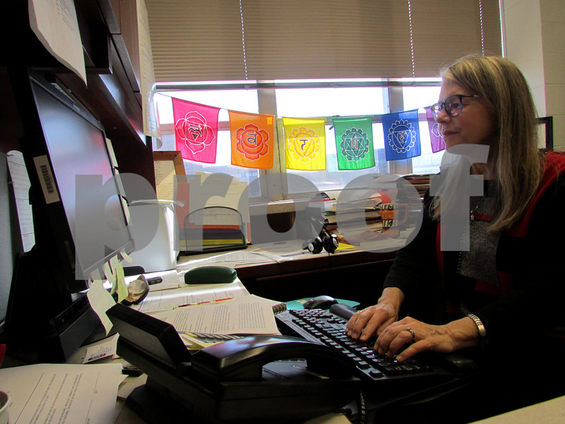 Suzanne Degges-White, a professor and chairwoman of the Department of Counseling, Adult and Higher Education at Northern Illinois University, checks emails Monday in her office. Degges-White is a licensed counselor whose academic research explores transitions and development with a strong focus on intimate family relationships and friendships.