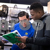 Sam Buckner for Shaw Media.<br /> Best Buy employee Jaime Barajas helps Michael Tayo find a laptop on Thursday November 24, 2016. Tayo was one of the first people in line before the doors opened at 4:50.