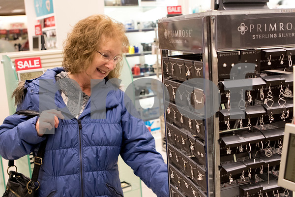 Sam Buckner for Shaw Media.<br /> Pat Brown looks at jewelry at Kohl's on Thursday November 24, 2016.