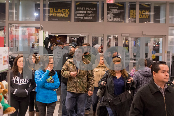 Sam Buckner for Shaw Media.<br /> Shoppers walk into Kohl's as they open their doors at 6:00 on Thursday November 24, 2016.