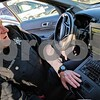 DeKalb police officer Jeff Winters shows off what the laptop in the police department's newest squad car can do. Funds from civil asset forfeiture in the DeKalb department go toward technology purchases and safety equipment, among other things.