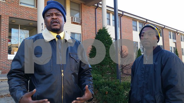 "Andre Williams (left), 40, of DeKalb, talks about the night Clarence Freeman, 39, of DeKalb, had a panic attack in the 800 block of Kimberly Drive in DeKalb, and no one batted an eye.<br /> <br /> ""These are your friends? And they're just sitting here? Not calling the police to get him some help?"" Williams said. ""This is what you live around, and they're allowing this to happen? If you can do something like that publicly, and nobody tries to get you help, something's wrong. If I hadn't been there, I don't know how things would have ended up."""