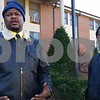 """Andre Williams (left), 40, of DeKalb, talks about the night Clarence Freeman, 39, of DeKalb, had a panic attack in the 800 block of Kimberly Drive in DeKalb, and no one batted an eye.<br /> <br /> """"These are your friends? And they're just sitting here? Not calling the police to get him some help?"""" Williams said. """"This is what you live around, and they're allowing this to happen? If you can do something like that publicly, and nobody tries to get you help, something's wrong. If I hadn't been there, I don't know how things would have ended up."""""""
