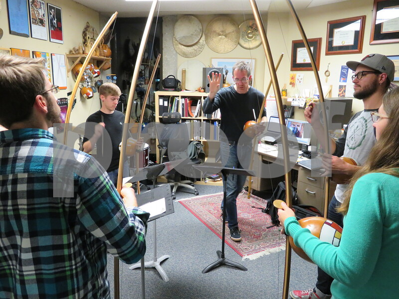 "Greg Beyer (center), head of percussion studies at Northern Illinois University, stops a run-through during a rehearsal in his office Sunday for the berimbau musical group Arcomusical. Arcomusical's album, ""MeiaMeia,"" is up for consideration for the 2018 Grammy Awards."
