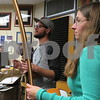 Arcomusical ensemble members Dan Eastwood and Raychel Taylor play a piece during a rehearsal Sunday for the berimbau musical group Arcomusical. The ensemble is preparing for Christmas concerts this week at the DeKalb Public Library.