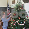 Kiyah Jones, 9, of Sycamore hangs ornaments during the Holiday Open House on Saturday at North Grove School in Sycamore.