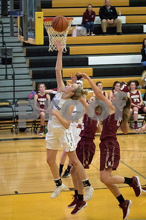 Sam Buckner for Shaw Media.<br /> Kylie Feuerbach takes a layup on Tuesday November 28, 2017 against Morris.