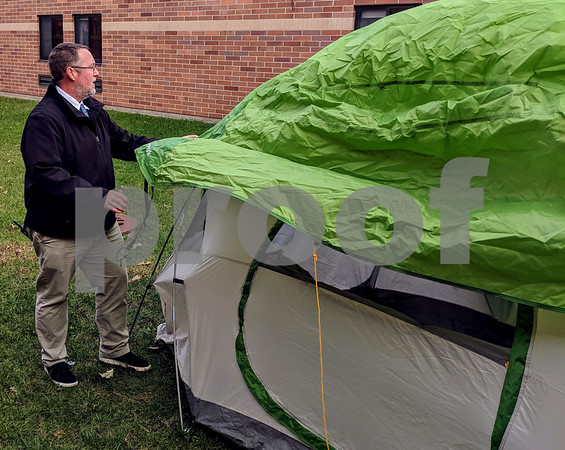 "South Prairie Elementary School Principal Kreg Wesley had to keep his word Monday night as he prepares a tent in the school's courtyard. He promised the students of his school that if they could read 7,000 books, he would sleep outside in the courtyard for a night. On Monday, he said he was glad the students met that mark in November and not January. The reading frenzy isn't over yet. When the school reaches 10,000 books reads, Wesley said he will dye his hair purple and at 12,000, he's shaving his head. ""We have kids reading like crazy,"" he said."