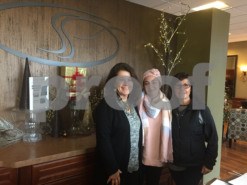 Studio One Salon and Spa owner Jane Seymour Levinsky (from left), receptionist Amanda Barone and manager Deb Kohler pose Tuesday at the salon at 1007 N. First St. in DeKalb. Studio One will celebrate its 40th anniversary during its annual holiday open house Monday.