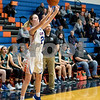 Sam Buckner for Shaw Media.<br /> Lily McPherson sinks a three pointer against Woodstock North on Wednesday November 28, 2018.