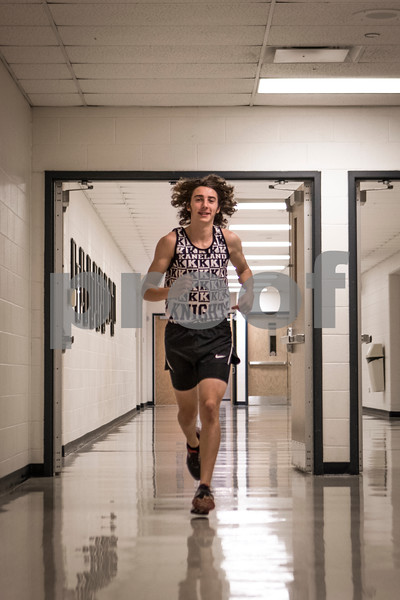 Sam Buckner for Shaw Media<br /> <br /> Matthew Richtman of Kaneland poses for a portrait as the boys cross country player of the year on Wednesday, Nov. 30, 2016 at Kaneland High School in Maple Park.