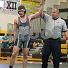 Sam Buckner for Shaw Media.<br /> Noah Butzman gets his hand raised after winning a 5-2 decision against Zak Kozumplik of Sycamore in the 170lb bout on Thursday November 30, 2017.