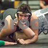Sam Buckner for Shaw Media.<br /> Joey Beaudoin of Sycamore pins Connor Park in the 285lb bout on Thursday November 30, 2017.