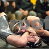 Sam Buckner for Shaw Media.<br /> Sycamore's James Cerny pins Kaneland's Jack Yore in the 145lb bout on Thursday November 30, 2017.