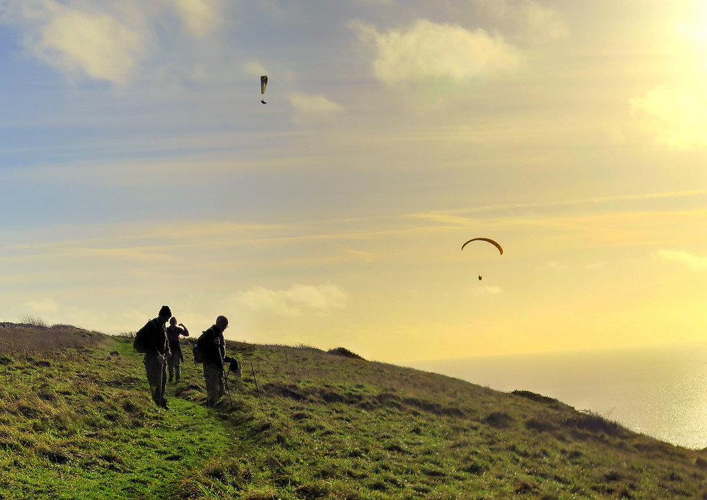 Paragliders take advantage of the freshening breeze on St Aldhelm's Head