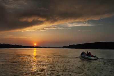 Europe, Romania, The Danube Delta, Mahmudia, sunset over Danube River