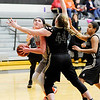 Don Knight | The Herald Bulletin<br /> Anderson University's Tatum Minier looks to shoot as she is guarded by Manchester's Maddy Minehart on Wednesday.