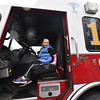 Jessica Chick, 7, of Leominster sits inside Leominster Engine 1 during the 11th annual celebration of the Martin T. Feldman Children's Room inside the Leominster Public Library on Sunday.  SENTINEL & ENTERPRISE JEFF PORTER