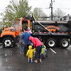 RLocal's brave the rain as they wait in line to sit inside of a Leominster DPW truck during the 11th annual celebration of the Martin T. Feldman Children's Room inside the Leominster Public Library on Sunday.  SENTINEL & ENTERPRISE JEFF PORTER