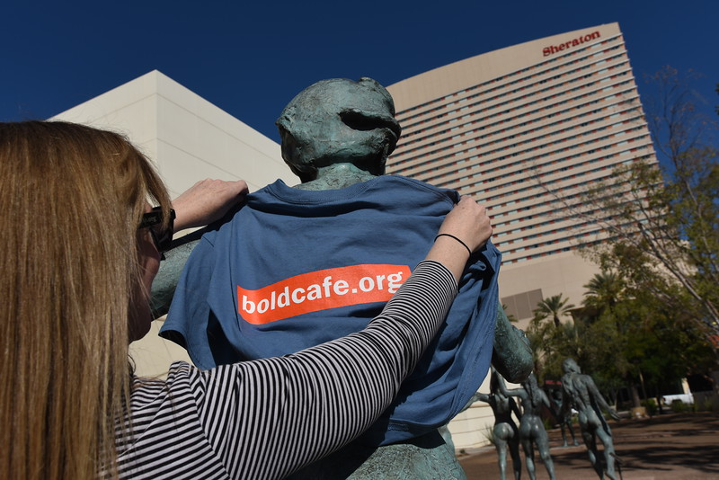 Boldcafe, Phoenix, Az. |  Elizabeth McBride, editor, hangs a boldcafe t-shirt on an unsuspecting statue in downtown Phoenix.