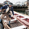 Bob Erbetta of Marblehead boards the long-boat for the annual row across Marblehead Harbor in commemoration of Washington's crossing of the Delaware on Saturday.